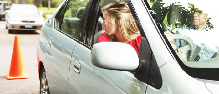 Woman looking in her rear view mirror whilst driving