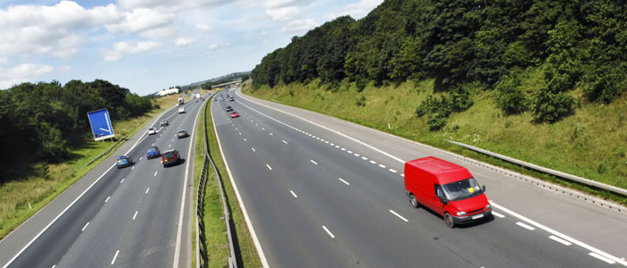 Red van driving on a motorway